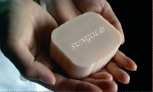 A 4oz bar of Sungold Soap in hands